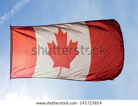 Canadian Flag in wind against the sky