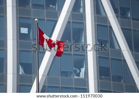 Canadian flag on calgary building background - stock photo