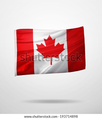 Canadian flag on plain background  - stock photo
