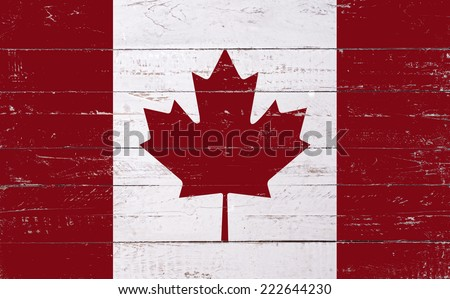 Canadian flag painted on a wooden board - stock photo