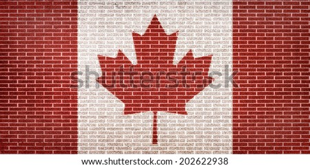 Canadian flag painted on brick wall - stock photo