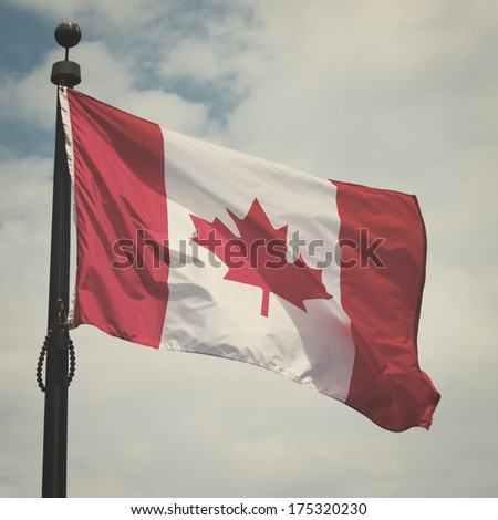 Canadian flag waving in the air with retro effect - stock photo