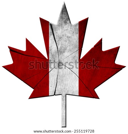 Canadian Flag - Wooden Leaf. Wooden leaf of maple with the colors of the flag of Canada. Isolated on white background - stock photo