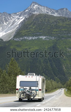 Canadian highway with motorhome and cars. British Columbia. Canada. Vertical - stock photo