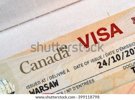 Canadian immigration Visa in passport - stock photo