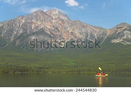 Canadian landscape with canoe in Pyramid lake. Alberta. Canada. Horizontal - stock photo