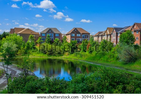 Canadian luxury houses by pond in a new development of Toronto - stock photo