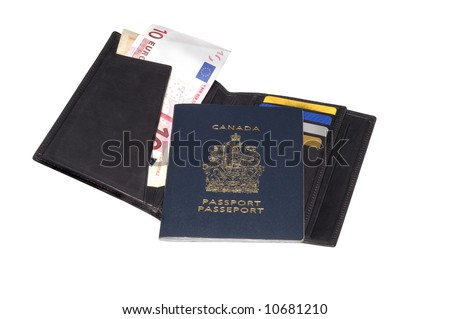 Canadian passport and a leather wallet full of credit cards and money bills - stock photo