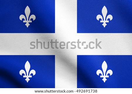 Canadian provincial flag, QC patriotic element and official symbol. Canada Quebec banner and background. Flag of the Canadian province of Quebec waving in the wind with detailed fabric texture