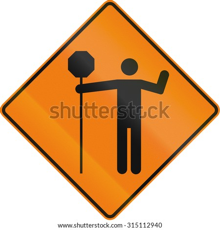 Canadian temporary traffic sign - traffic control person ahead. This sign is used in Quebec.