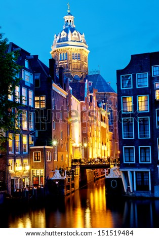 Canal and St. Nicolas Church in Amsterdam - stock photo