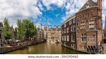 Canal and St. Nicolas Church in Amsterdam, Netherlands in a summer day - stock photo
