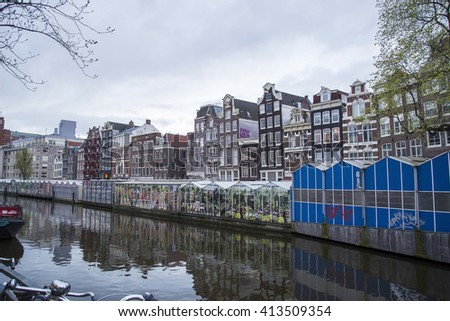Canal behind the Flower Market in Amsterdam Amsterdam, Holland AMSTERDAM, NEDERLAND - : City Center on April 15, 2016 in Amsterdam.