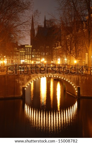 Canal bridge at night, with silhouette of castle Amsterdam, Netherlands
