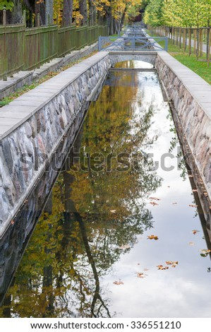 Canal closeup with autumn tree reflection in water, Kadriorg, Tallinn, Estonia