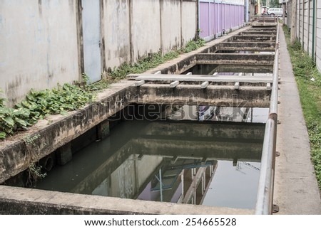 canal drain in town  - stock photo