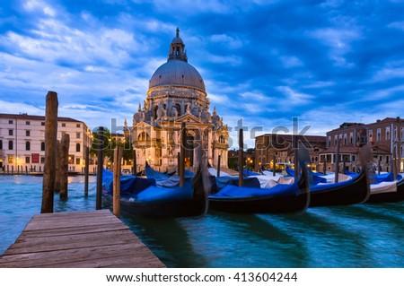 Canal Grande and Basilica di Santa Maria della Salute in Venice, Italy - stock photo