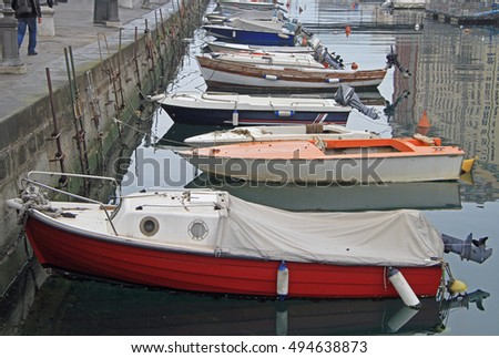 Canal grande with boats in Trieste city center, Italy