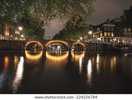 Canal in Amsterdam at night - stock photo