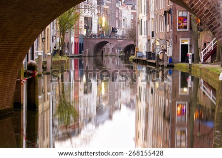 Canal in the city of Utrecht, the center city of the Netherlands, with beautiful reflections of the medieval quaint houses in the water - stock photo