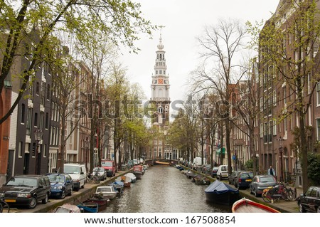 Canal of  amsterdam with church, Netherland - stock photo