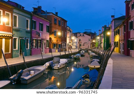 Canal reflections at dusk in Burano island - Venice, Venezia, Italy, Europe - stock photo