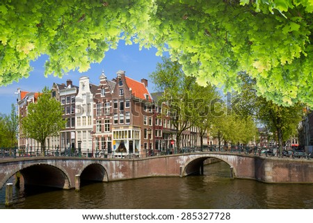 Canal ring in  Amsterdam old town with green trees at summer day, Holland