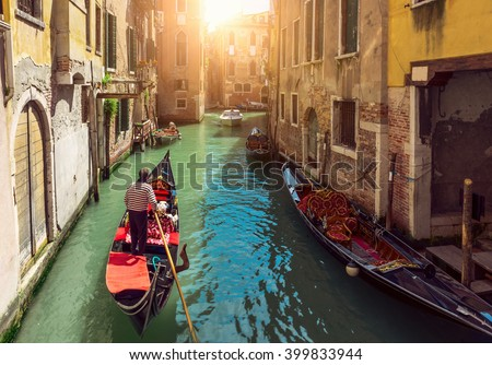 Canal with gondolas in Venice, Italy - stock photo
