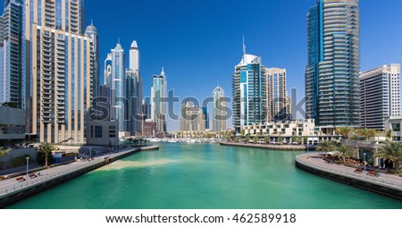 Canal with yachts and luxury skyscrapers in Dunai Marina, Dubai, United Arab Emirates