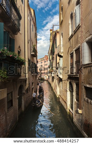 Canals and exterior of old building of Venice