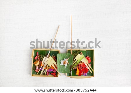 Canang sari traditional offering for spirits of Bali island at ceremony Melasti before Balinese New Year and silence day Nyepi. Holidays, festivals, rituals, culture, art objects, of Indonesian people - stock photo