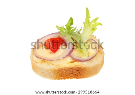 Canape, brie cheese, red onion, tomato and lettuce on French bread isolated against white - stock photo