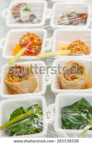 Canape ; Decoration and foods that are wrapped with plastic wrap prepared for the wedding - stock photo