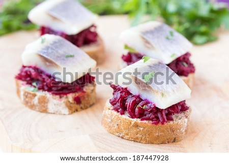 Canape herring with beets on rye toast, Russian appetizer for vodka - stock photo
