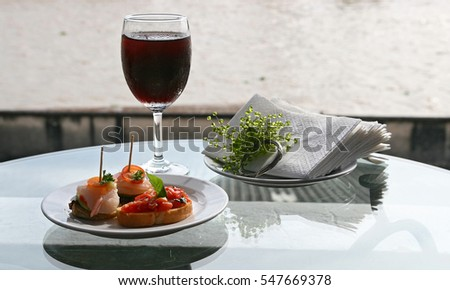 Canape juicy tomatoes shrimp cocktail with wine on dining table