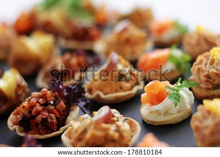 canape selection on slate platter - stock photo