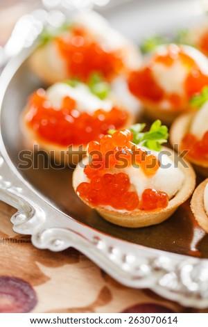 canape with caviar - stock photo