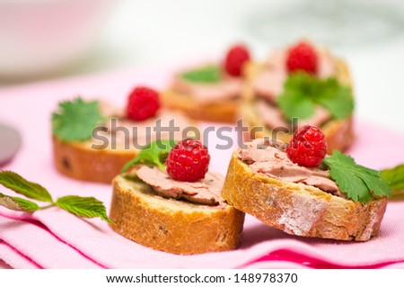 Canape with hand-made perigueux truffle paste ( pate) and raspberries - stock photo