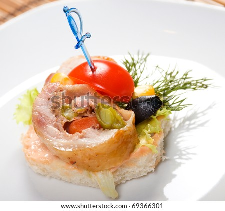 Canape with meat loaf. Shallow depth-of-field. close up - stock photo