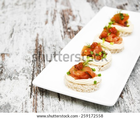canape with salmon and dill for party - stock photo
