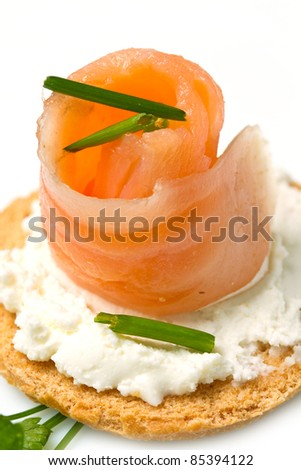 Canape with Salmon on white dish - stock photo