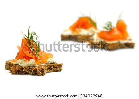 canapes for a christmas dinner dark bread in star shape with smoked salmon on cream cheese and dill garnish r, isolated on a white background, selected focus, narrow depth of field - stock photo