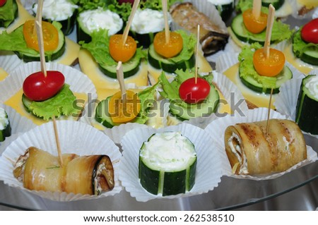 Canapes on appetizer table - stock photo