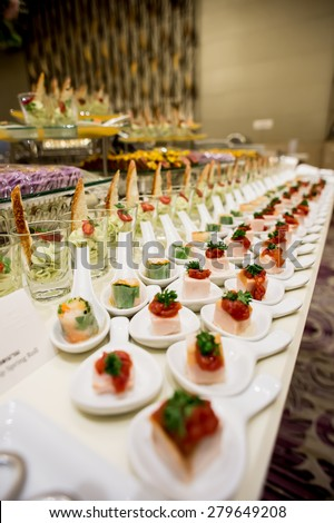 canapes on toothpicks , appetizer, pinchos , spanish food ,delicious finger food, - stock photo