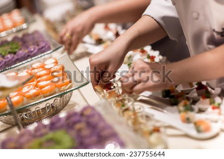 canapes on toothpicks , appetizer, pinchos , spanish food ,delicious finger food,Hand held delicious finger food - stock photo