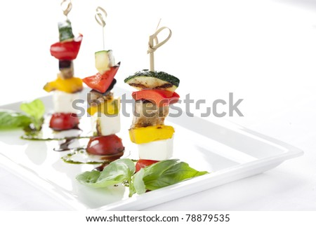 Canapes with cheese and vegetables on the plate