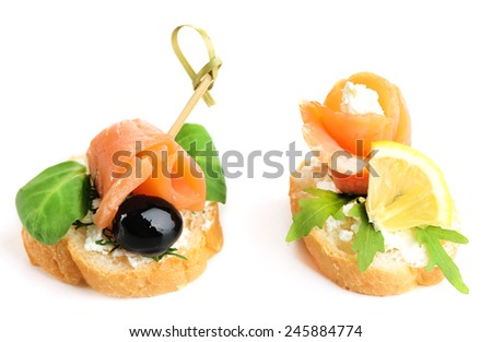 Canapes with salmon and herbs isolated on white - stock photo