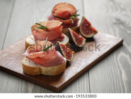 canapes with spanish jamon, spanish traditional food - stock photo