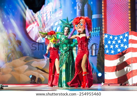 CANARY ISLAND, SPAIN - FEBRUARY 20, 2015: Drag Dafne del Giogio (m) as Statue of Liberty and unidentified assistants with comic costumes performing onstage during Las Palmas carnival Drag Queen Gala. - stock photo