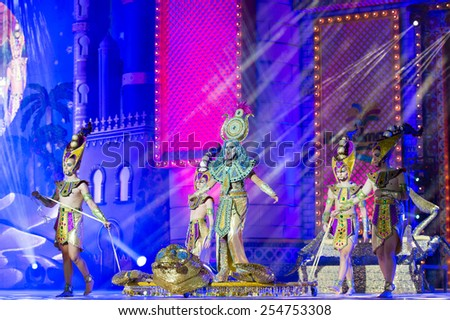 CANARY ISLAND, SPAIN - FEBRUARY 20, 2015: Drag Sethlas (m) as Cleopatra and unidentified assistants with Egyptian costumes performing onstage during city of Las Palmas carnival Drag Queen Gala. - stock photo